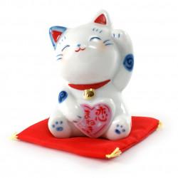 Chat porte-bonheur japonais manekineko pour inviter l'amour