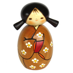 Japanese brown kokeshi doll with spring expectation pattern, HARU YO KOI