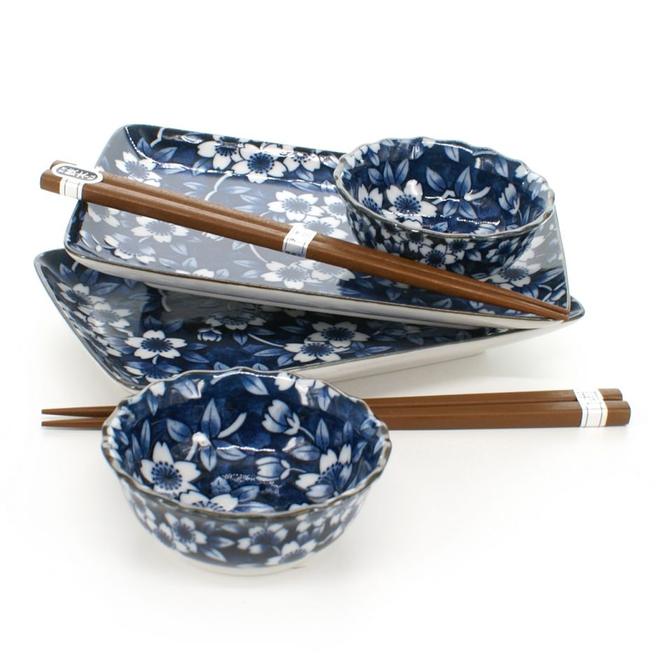 2 plates 2 bowls set with flower patterns and pairs of chopsticks white and blue SHIMITSU