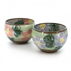 pair of tea cups with purple and pink flower patterns green MARGARET YUTTARI